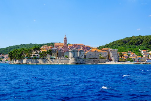 View of old city from the sea, with city walls and towers, the cathedral, in Korcula, Croatia