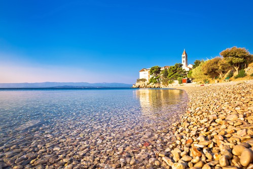 Monastery on pebble beach in Bol, island of Brac, Dalmatia, Croatia