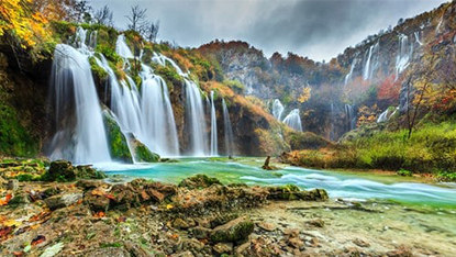 Spectacular waterfalls in forest Plitvice Lakes